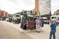 """Bauern aus Schleswig-Holstein, Niedersaschsen und Brandenburg protestieren am Mittwoch den 17. Juni 2020 auf dem Potsdamer Platz in Berlin mit einer Mahnwache  fuer bessere Bezahlung. An den meissten Treckern waren Fahnen der norddeutschen """"Landvolkbewegung"""" (schwarze Fahne mit einem stilisierten Pflug und einem roten Schwert) aus den 1920er Jahren angebracht. Mitglieder der national-voelkischen und antisemitischen """"Landvolkbewegung"""" veruebten in den 1920er Jahren Anschlaege auf anders gesinnte Bauern, auf Landrats- und Finanzaemter sowie Privathaeuser von Regierungsbeamten. In der Nachkriegszeit nutzen Alt- und Neonazis den Namen und das Symbol.<br /> 17.6.2020, Berlin<br /> Copyright: Christian-Ditsch.de<br /> [NUR FUER REDAKTIONELLE ZWECKE! Werbung nur auf Anfrage beim Fotografen. Inhaltsveraendernde Manipulation des Fotos nur nach ausdruecklicher Genehmigung des Fotografen. Vereinbarungen ueber Abtretung von Persoenlichkeitsrechten/Model Release der abgebildeten Person/Personen liegen nicht vor. NO MODEL RELEASE! Don't publish without copyright Christian-Ditsch.de, Veroeffentlichung nur mit Fotografennennung, sowie gegen Honorar, MwSt. und Beleg. Konto: I N G - D i B a, IBAN DE58500105175400192269, BIC INGDDEFFXXX, Kontakt: post@christian-ditsch.de<br /> Bei der Bearbeitung der Dateiinformationen darf die Urheberkennzeichnung in den EXIF- und  IPTC-Daten nicht entfernt werden, diese sind in digitalen Medien nach §95c UrhG rechtlich geschuetzt. Der Urhebervermerk wird gemaess §13 UrhG verlangt.]"""