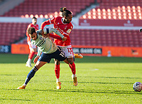 9th January 2021; City Ground, Nottinghamshire, Midlands, England; English FA Cup Football, Nottingham Forest versus Cardiff City; Josh Murphy of Cardiff City and Gaetan Bong of Nottingham Forest tussle for the ball