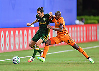 LAKE BUENA VISTA, FL - JULY 18: Diego Valeri #8 of the Portland Timbers is pressured by Óscar Boniek García #27 of the Houston Dynamo in midfield during a game between Houston Dynamo and Portland Timbers at ESPN Wide World of Sports on July 18, 2020 in Lake Buena Vista, Florida.