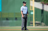 Umpire Justin Anderson handles the calls on the bases during the South Atlantic League game between the Greenville Drive and the Kannapolis Intimidators at Intimidators Stadium on June 7, 2016 in Kannapolis, North Carolina.  The Drive defeated the Intimidators 4-1 in game one of a double header.  (Brian Westerholt/Four Seam Images)