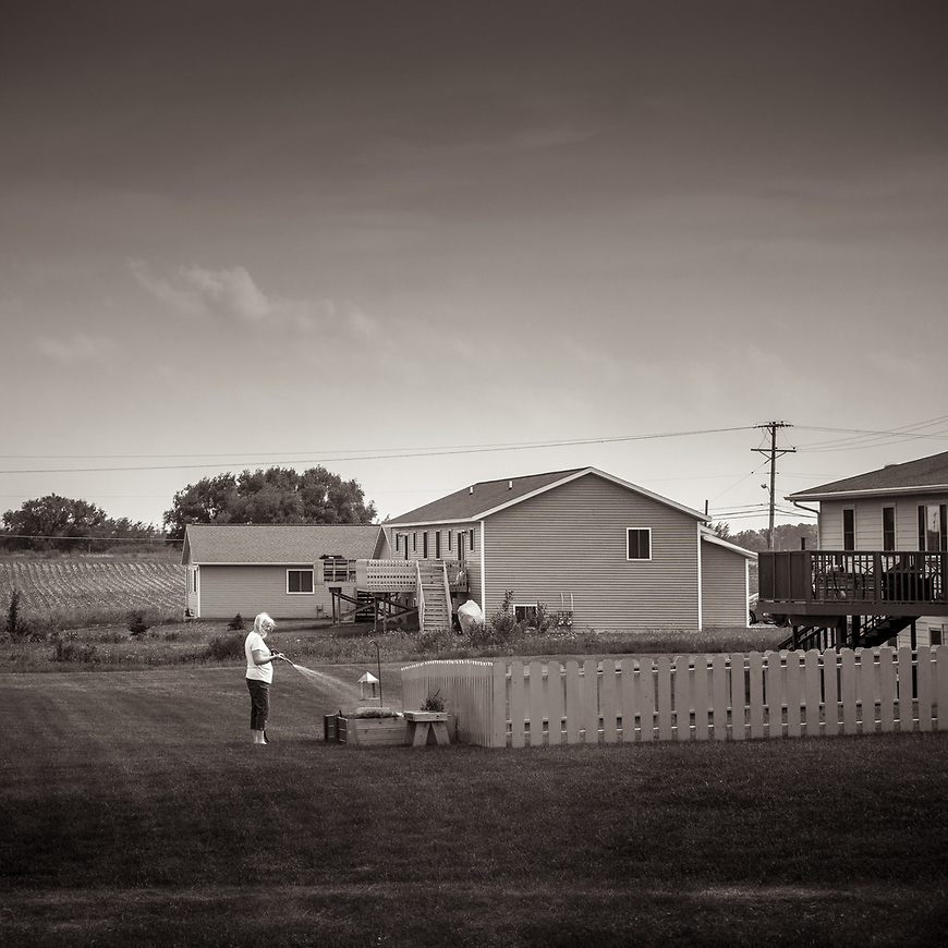 "WELCOMING SUMMER -- Nothing says ""Summer"" like watering flowers in your backyard. Marshfield, Wisconsin, USA.<br /> #michaelknapstein #midwestmemoir #blackandwhite #B&W #monochrome #motherfstop #wisconsin  #bwphotography #myfeatureshoot  #fineartphotography #americanmidwest #squaremag #lensculture #mifa #moscowfotoawards #moscowinternationalfotoawards #rps #royalphotographicsociety #CriticalMass #CriticalMassTop200 #photolucida  #portfolioshowcase11 #thegalaawards #thepolluxawards #flakphoto #ipe160 #ipe161 #grainedephotographe  #galleryofwisconsinart"