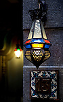 A traditional lamp lights a doorway in the in the Jewish Quarter of the Old City.