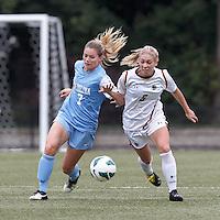 University of North Carolina forward Kealia Ohai (7) and Boston College midfielder Lauren Bernard (5) battle for the ball.   University of North Carolina (blue) defeated Boston College (white), 1-0, at Newton Campus Field, on October 13, 2013.