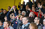 Ross County fans grab the boots of Yoann Arquin at full time
