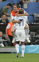French teammates (22) Frank Ribery and (11) Sylvain Wiltord celebrate their victory.  France defeated Portugal, 1-0, in their FIFA World Cup semifinal match at FIFA World Cup Stadium in Munich, Germany, July 5, 2006.