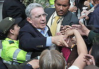 BOGOTA –COLOMBIA  - 09-03-2014: Álvaro Uribe Vélez, ex presidente de Colombia, saluda a sus seguidores después de ejercer su derecho al voto durante las elecciones parlamentarias en Bogotá, Colombia, hoy 9 de marzo de 2014. Los colombianos elegirán por voto directo en las urnas 102 nuevos miembros del Senado de la República, 166 representantes a la Cámara de Representantes y 5 representantes al Parlamento Andino. / Alvaro Uribe Velez, former President of Colombia, greets his supporters after exerts his right to vote in the parliamentary elections in Bogota, Colombia, today March 9, 2014. Colombians will elect by direct vote at the polls 102 new members of the Senate, 166 representatives to the House of Representatives and five representatives to the Andean Parliament. Photo: VizzorImage/ Luis Ramirez / Staff