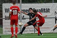 Lukas Dilling (#6 Büttelborn) zieht ab und trifft gegen Kim Ginkel (Geinsheim) zum 1:3 - Büttelborn 03.10.2021: SKV Büttelborn vs. SV 07 Geinsheim, Gruppenliga