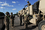 """American soldiers with the 15th Engineer Battalion help unload $28.5 million of equipment for a two week-long NATO exercise at the Drawsko Pomorskie Training Area in Poland on June 10, 2015.  NATO is engaged in a multilateral training exercise """"Saber Strike,"""" the first time Poland has hosted such war games, involving the militaries of Canada, Denmark, Germany, Poland, and the United States."""