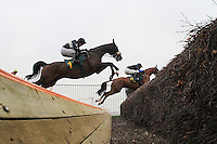 Race winner American Cricket ridden by Paul Moloney (L) jumps the open ditch during the the Robert Case Memorial Beginners Chase at Fakenham Racecourse, Norfolk - 16/03/12 - MANDATORY CREDIT: Gavin Ellis/TGSPHOTO - Self billing applies where appropriate - 0845 094 6026 - contact@tgsphoto.co.uk - NO UNPAID USE.