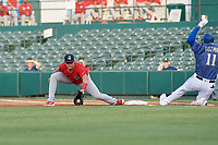 Springfield Cardinals first baseman Chris Chinea (26) picks a throw as Ronald Guzman (11) slides in during a Texas League game against the Frisco RoughRiders on May 6, 2019 at Dr Pepper Ballpark in Frisco, Texas.  (Mike Augustin/Four Seam Images)