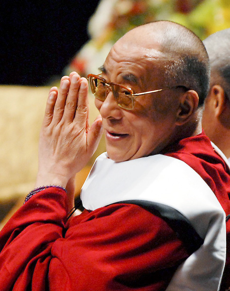 The Dalai Lama sends thanks to the faculty and audicence at a public lecture on the campus of Lehigh University following his receiving and Honorary Degree Sunday, July 13, 2008, in Bethlehem, Pa. (AP Photos/Bradley C Bower)