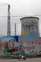 "A coal-fired power station spews out pollution in front of a billboard advertising the Beijing olympics with the slogan ""One World One Dream"" in the city of Shenyang, China. Shenyang, 300 north east of Beijing, is one of mainland China's Olympic cities and will be hosting footballing events for the summer games. Beijing has been roundly criticized for the air quality which it has promised to clean-up by August 08th for the opening ceremony. Independant analysis of the pollution levels around the national stadium the week ending 06 July found them five times World Health Organisation safety levels..09 Jul 2008"