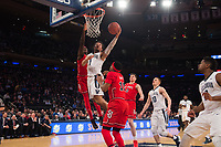 NEW YORK, NY - Thursday March 9, 2017: Jalen Brunson (#1) of Villanova goes up for a lay-up against St. John's as the two schools square off in the Quarterfinals of the Big East Tournament at Madison Square Garden.
