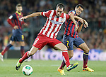 FC Barcelona's Pedro Rodriguez (r) and Atletico de Madrid's Diego Godin during Supercup of Spain 2nd match.August 28,2013. (ALTERPHOTOS/Acero)