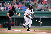 First baseman Tyreque Reed (38) of the Greenville Drive in a game against the Asheville Tourists on Tuesday, June 1, 2021, at Fluor Field at the West End in Greenville, South Carolina. The umpire is Adam Pierce. (Tom Priddy/Four Seam Images)