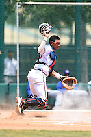 GCL Braves catcher Alejandro Flores (50) looks for a blocked pitch in the dirt during a game against the GCL Blue Jays on June 27, 2014 at the ESPN Wide World of Sports in Orlando, Florida.  GCL Braves defeated GCL Blue Jays 10-9.  (Mike Janes/Four Seam Images)