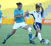 17 August 2004:   Mia Hamm dribbles the ball away from Dianne Alagich from Australia at Kaftanzoglio Stadium in Thessaloniki, Greece.     USA tied Australia at 1-1.   Credit: Michael Pimentel / ISI