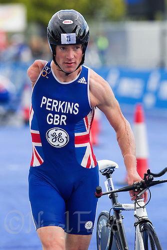 07 AUG 2011 - LONDON, GBR - Tom Perkins (GBR) runs out of transition for the start of the bike during the paratriathlon at triathlon's ITU World Championship Series event (PHOTO (C) NIGEL FARROW)