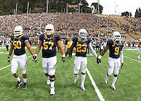 California captains' Aaron Tipoti, Brian Schwenke, Josh Hill and C.J. Anderson walk on the field for coin toss before the game against Nevada at Memorial Stadium in Berkeley, California on September 1st, 2012.  Nevada Wolf Pack defeated California, 31-24.