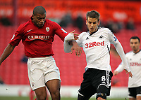 Pictured L-R: Miles Addison of Barnsley against Andrea Orlandi of Swansea. Saturday 07 January 2012<br /> Re: FA Cup football Barnsley FC v Swansea City FC at the Oakwell Stadium, south Yorkshire.