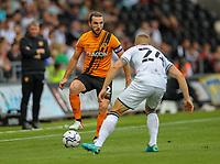 11th September 2021; Swansea.com Stadium, Swansea, Wales; EFL Championship football, Swansea versus Hull City; Lewie Coyle of Hull City controls the ball while under pressure from Jake Bidwell of Swansea City