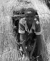 Karamoja, Uganda , Africa. - women making grain bin