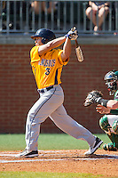 Mike Krische (3) of the Canisius Golden Griffins follows through on his swing against the Charlotte 49ers at Hayes Stadium on February 23, 2014 in Charlotte, North Carolina.  The Golden Griffins defeated the 49ers 10-1.  (Brian Westerholt/Four Seam Images)