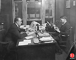 Waterbury Democrat employees share the same desk to complete a day's work, circa 1925.