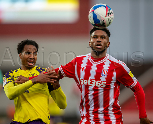 21st November 2020; Bet365 Stadium, Stoke, Staffordshire, England; English Football League Championship Football, Stoke City versus Huddersfield Town; Tyrese Campbell of Stoke City and Dermeaco Duhaney of Huddersfield Town have their eyes on the ball