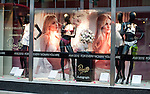 """Window display at Marks and Spencer for..Rosie Huntington-Whitely.At M&S Oxford St.to promote her new range of underwear - lingerie -.""""Rosie for Autograph."""".On the way in she paused to kiss strange long haired blonde man.....Pic by Gavin Rodgers/Pixel 8000 Ltd"""
