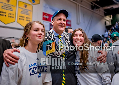 16 March 2019: University of Vermont Catamount Head Coach John Becker wears the game net around his neck, posing for photos to celebrate a victory against the UMBC Retrievers in the America East Championship Game at Patrick Gymnasium in Burlington, Vermont. The Catamounts defeated the Retrievers 66-49, avenging their loss against the same team in last years' Championship Game. Mandatory Credit: Ed Wolfstein Photo *** RAW (NEF) Image File Available ***
