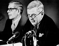 William Mulholland, president of the bank of Montreal, foreground, told economic conference there's reason for optimism in longer tern, but immediate forecast is glum. with Mulholland is R. M. Forster, senior vice-president, Metropolitan Ontario Division, of the bank.