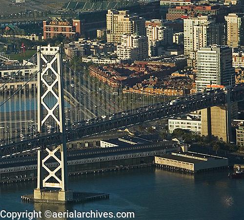 aerial photograph of San Francisco Oakland Bay Bridge, South Beach San Francisco California, AT&T Park and Embarcadero in background