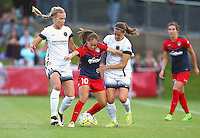 Boyds, MD - Saturday May 07, 2016: Washington Spirit midfielder Estefania Banini (10) caught between Portland Thorns FC midfielder Dagny Brynjarsdottir (11) and  defender Katherine Reynolds (2) during a regular season National Women's Soccer League (NWSL) match at Maureen Hendricks Field, Maryland SoccerPlex. Washington Spirit tied the Portland Thorns 0-0.