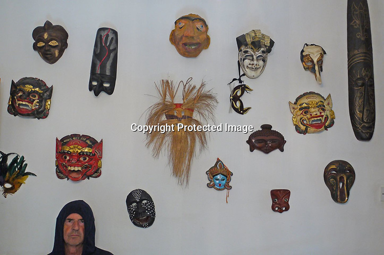 A collection of masks from different cultures around the world and the photographer is amongst them.<br /> <br /> Stock Photo by Paddy Bergin
