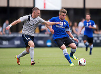 Cole Seiler (14) of Georgetown closes in on Marvin Iskra (13) of Creighton during the game at Shaw Field on the campus of the Georgetown University in Washington, DC.  Georgetown tied Creighton, 0-0, in double overtime.