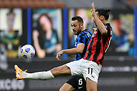 Stefan de Vrij of FC Internazionale and Zlatan Ibrahimovic of AC Milan compete for the ball during the Serie A football match between FC Internazionale and AC Milan at stadio San Siro in Milano (Italy), October 17th, 2020. Photo Image Sport / Insidefoto