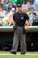 Home plate umpire Gabe Morales during the International League game between the Durham Bulls and the Charlotte Knights at Knights Stadium on August 18, 2013 in Fort Mill, South Carolina.  The Bulls defeated the Knights 8-5 in Game One of a double-header.  (Brian Westerholt/Four Seam Images)