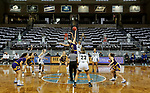 SIOUX FALLS, SD - MARCH 7: Evan Zars #54 of the Western Illinois Leathernecks jumps the opening tip against Jada Mickens #32 of the UMKC Kangaroos during the Summit League Basketball Tournament at the Sanford Pentagon in Sioux Falls, SD. (Photo by Dave Eggen/Inertia)