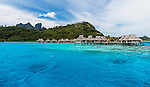 Resort with overwater bungalows, in Bora Bora lagoon, French Polynesia