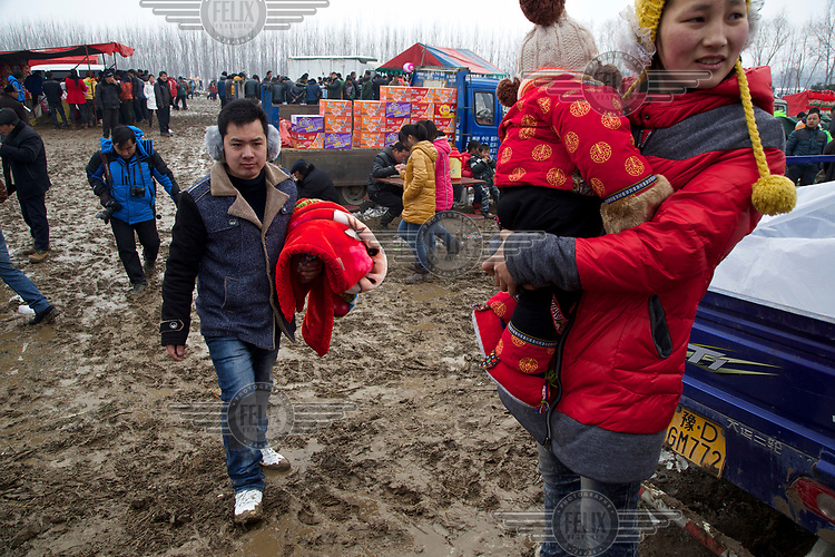 A farmer arrives at the site of the Ma Jie folk festival. <br /> <br /> For centuries farmers in Henan have gathered during Chinese New Year in the region's wheat fields to listen to bards singing and recounting old tales. <br /> <br /> Now storytellers come from all over China to attend the annual festival where large crowds gather to watch the best performers.