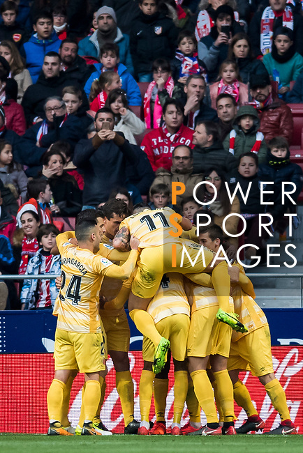 Cristian Portugues Manzanera, Portu, of Girona FC celebrates his goal with teammates during the La Liga 2017-18 match between Atletico de Madrid and Girona FC at Wanda Metropolitano on 20 January 2018 in Madrid, Spain. Photo by Diego Gonzalez / Power Sport Images