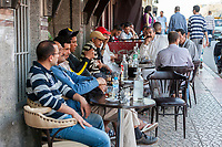Meknes, Morocco.  Men at a Sidewalk cafe.