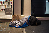 Rough sleeper outside a shoe store, Oxford Street, London.