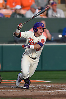 Left fielder Robert Jolly (12) of the Clemson Tigers bats in a game against the Furman Paladins on Tuesday, February 20, 2018, at Doug Kingsmore Stadium in Clemson, South Carolina. Clemson won, 12-4. (Tom Priddy/Four Seam Images)