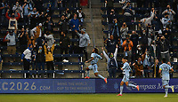 KANSAS CITY, KS - APRIL 23: Gianluca Busio #10, Daniel Salloi #20 and Roger Espinoza #15 of Sporting Kansas City celebrate Busio's goal at the end of the first half during a game between Orlando City SC and Sporting Kansas City at Children's Mercy Park on April 23, 2021 in Kansas City, Kansas.