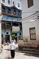 Zanzibar, Tanzania.  Stone Town Street Scene.  Indian, South-Asian Architectural Influence.