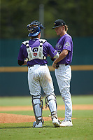 Catcher Satchell Norman (19) of Sarasota HS in Sarasota, FL playing for the Colorado Rockies scout team chats with pitcher Kade Woods (32) of Ouachita Christian School in Monroe, LA during the East Coast Pro Showcase at the Hoover Met Complex on August 4, 2020 in Hoover, AL. (Brian Westerholt/Four Seam Images)