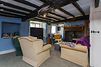 BNPS.co.uk (01202) 558833. <br /> Pic: Savills/BNPS<br /> <br /> Pictured: Cozy sitting room. <br /> <br /> Property buyers who want to get away from it all can buy a traditional Lakeland farm in their own private valley for £2m.<br /> <br /> Dowthwaite Head is in a beautiful and quiet part of the Lake District National Park, in a private valley with a stream running through it.<br /> <br /> The valley was once home to a community of farms, which are no longer there, but a number of barns and abandoned farmhouses remain.<br /> <br /> Dowthwaite Head has about 292 acres with a traditional farmhouse and a number of other buildings with development potential.<br /> <br /> The picturesque valley has undulating grassland interspersed with woodlands, rising towards the striking Lakeland Fells.
