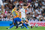 Marco Asensio Willemsen (r) of Real Madrid battles for the ball with Daniel Parejo Munoz of Valencia CF during their La Liga 2017-18 match between Real Madrid and Valencia CF at the Estadio Santiago Bernabeu on 27 August 2017 in Madrid, Spain. Photo by Diego Gonzalez / Power Sport Images